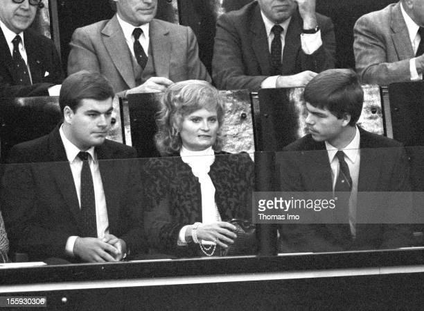 Hannelore Kohl sitting with her sons Walter and Peter at the grand stand of the German Bundestag during the noconfidence vote October 01 Bonn Germany