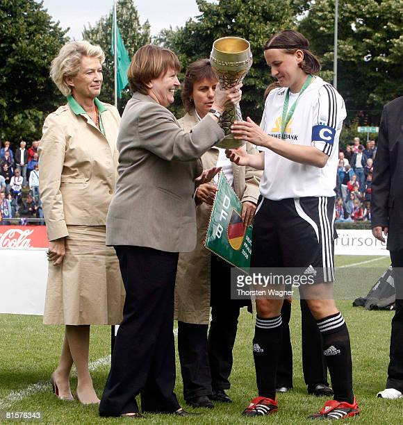 Hannelore Ratzenburg 2nd president of the german football association called DFB overgive the cup to Pia Wunderlich of 1FFC Frankfurt after the women...