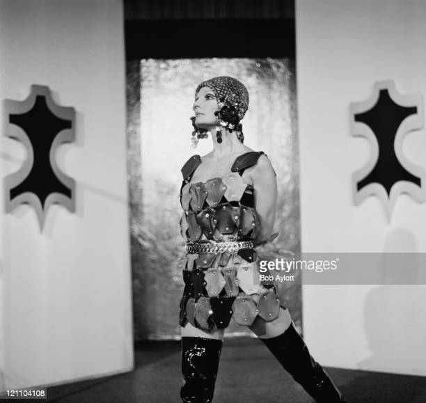 Hannerle models a multicoloured openwork dress designed by Eddie Canton for Nutone at the 9th Annual Leather Fashion Fair at the Hilton Hotel in...