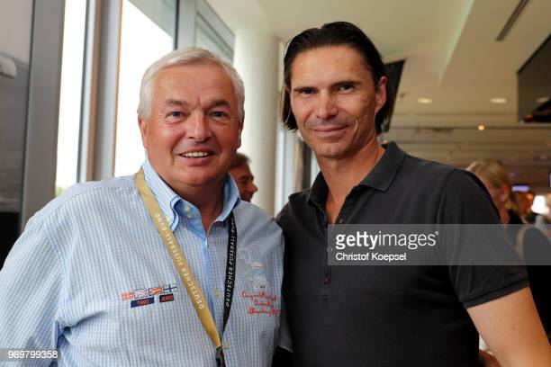 Hannes Bongartz and Thomas Brdaric pose during the Club Of Former National Players Meeting at BayArena on June 8 2018 in Leverkusen Germany