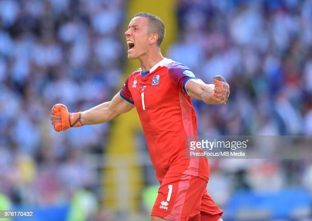 Hannes Halldorsson of Iceland celebrates goal scored by Alfred Finnbogason of Iceland during the 2018 FIFA World Cup Russia group D match between...