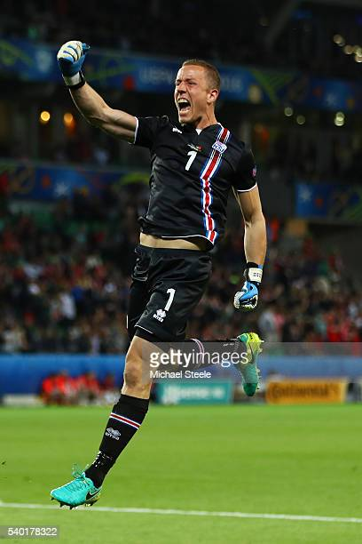 Hannes Halldorsson of Iceland celebrates his team's first goal during the UEFA EURO 2016 Group F match between Portugal and Iceland at Stade...