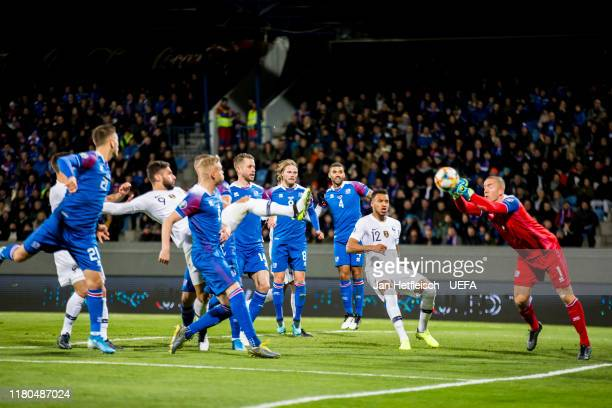 Hannes Halldorsson of Iceland fights for the ball during the UEFA Euro 2020 qualifier between Iceland and France on October 11 2019 in Reykjavik...