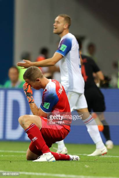 Hannes Halldorsson of Iceland kneels down dejected after conceding his sides second goal during the 2018 FIFA World Cup Russia group D match between...
