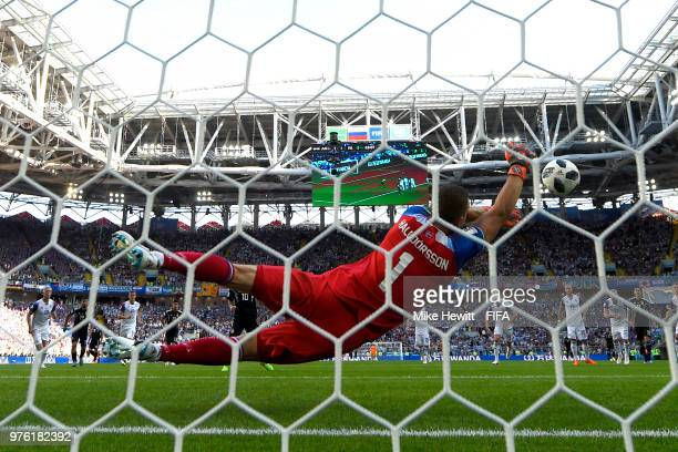 Hannes Halldorsson of Iceland saves a penalty kick from Lionel Messi of Argentina during the 2018 FIFA World Cup Russia group D match between...