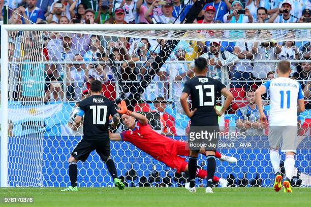 Hannes Halldorsson of Iceland saves the penalty kick of Lionel Messi of Argentina during the 2018 FIFA World Cup Russia group D match between...