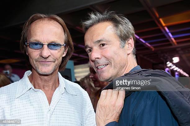 Hannes Jaenicke and Eisi Gulp attend the 'Die reichen Leichen Ein Starnbergkrimmi' premiere as part of Filmfest Muenchen at CarlOrffSaal on July 3...