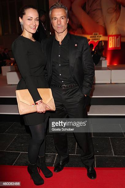 Hannes Jaenicke and Sarah Maria Besgen attend the Ein Herz fuer Kinder Gala 2014 after show party at Tempelhof Airport on December 6 2014 in Berlin...