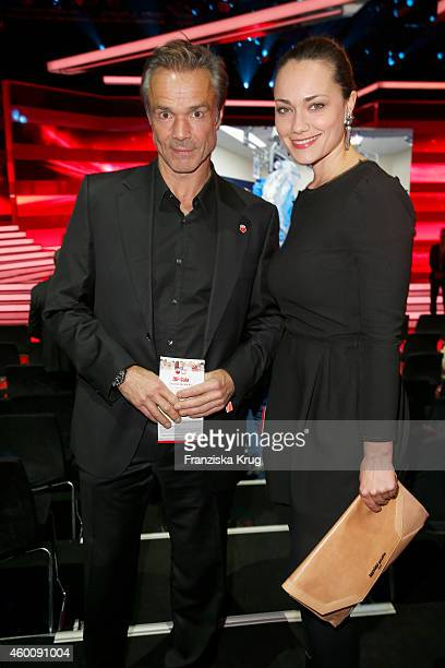 Hannes Jaenicke and Sarah Maria Besgen attend the Ein Herz Fuer Kinder Gala 2014 Red Carpet Arrivals on December 6 2014 in Berlin Germany