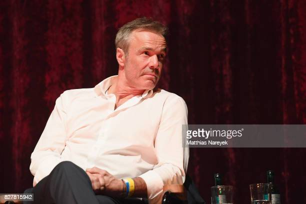 Hannes Jaenicke speaks on stage at a QA after a special screening of 'An Inconvenient Sequel Truth to Power' at Zoo Palast on August 8 2017 in Berlin...