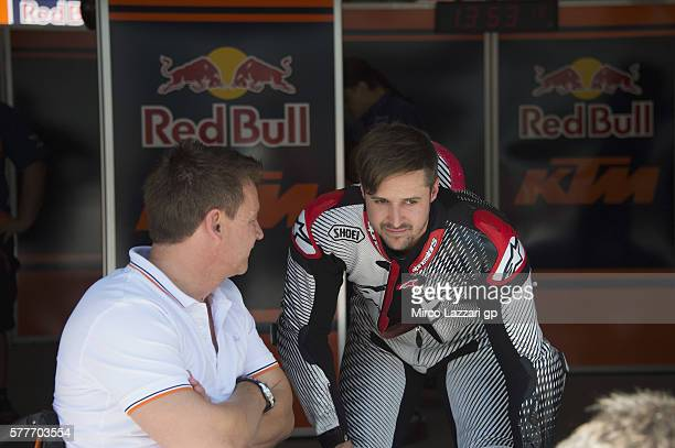 Hannes Kinigadner of Austria and KTM Team spaks with Tom Luthi of Switzerland and KTM Team in box during the first day of MotoGP Tests In Zwelteg at...