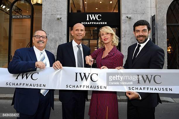 Hannes Pantli board IWC member Beppe Ambrosini Brand Manager IWC Italia Alessia Marcuzzi and Pierfrancesco Favino attend IWC Boutique Opening Event...