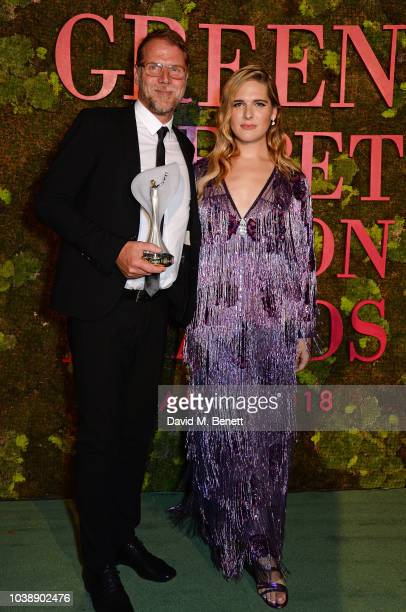 Hannes Parth accepting the Technology and Innovation Award on behalf of Frumat Leather and Hari Nef pose backstage at The Green Carpet Fashion Awards...