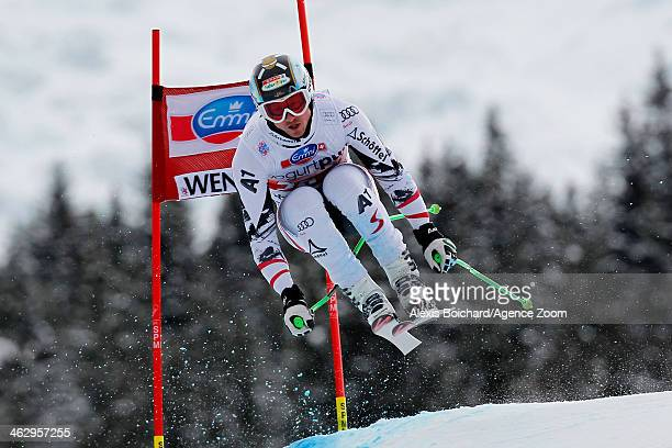 Hannes Reichelt of Austria competes during the Audi FIS Alpine Ski World Cup Men's Downhill Training on January 16 2014 in Wengen Switzerland