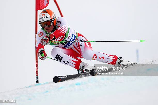 Hannes Reichelt of Austria competes in the Men's giant slalom event of the Men's Alpine Skiing FIS World Cup at the Rettenbachgletscher on October...