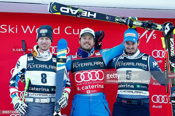 Hannes Reichelt of Austria takes 2nd place, Kjetil Jansrud of Norway takes 1st place, Dominik Paris of Italy takes 3rd place during the Audi FIS...