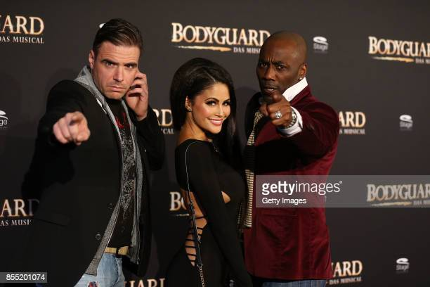 Hannes Staffler Michaela Grauke and Trevor Jackson attend the black carpet at the 'Bodyguard Das Musical' premiere at Stage Palladium Theater on...
