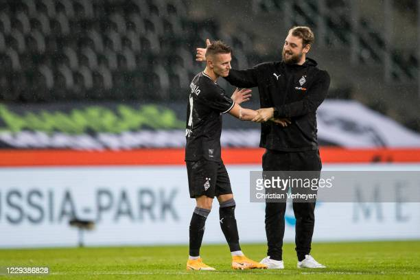 Hannes Wolf and Assistant Coach Rene Maric of Borussia Moenchengladbach celebrate their victory after the Bundesliga match between Borussia...