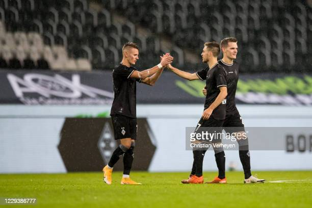 Hannes Wolf and Patrick Herrmann of Borussia Moenchengladbach celebrate their victory after the Bundesliga match between Borussia Moenchengladbach...
