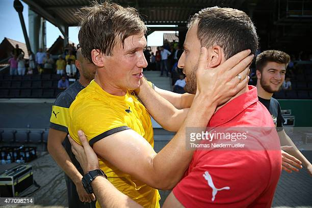 Hannes Wolf head coach of Dortmund and Domenico Tedesco head coach of Stuttgart are seen after the Bjuniors German championship final between VfB...