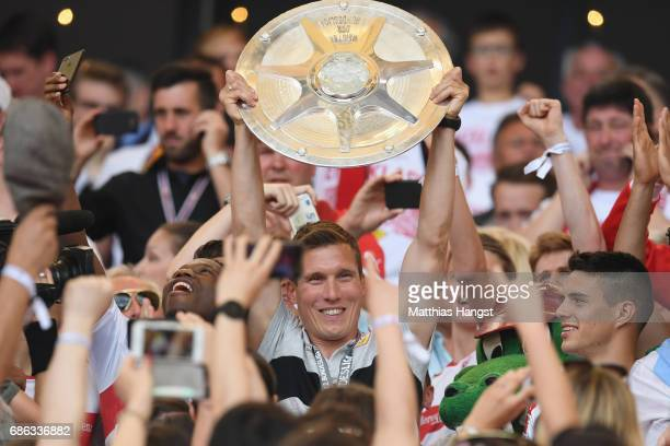 Hannes Wolf head coach of Stuttgart celebrates winning the 2 Second Bundesliga Championship title with the Championship trophy after the 2 Second...