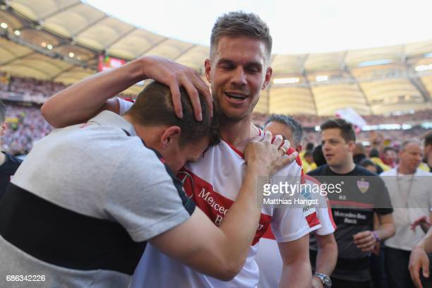 Hannes Wolf head coach of Stuttgart celebrates winning the 2 Second Bundesliga Championship title with his player Simon Terodde after the 2 Second...