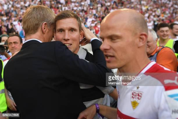 Hannes Wolf head coach of Stuttgart celebrates winning the 2 Second Bundesliga Championship title with team manger Jan Schindelmeiser after the 2...
