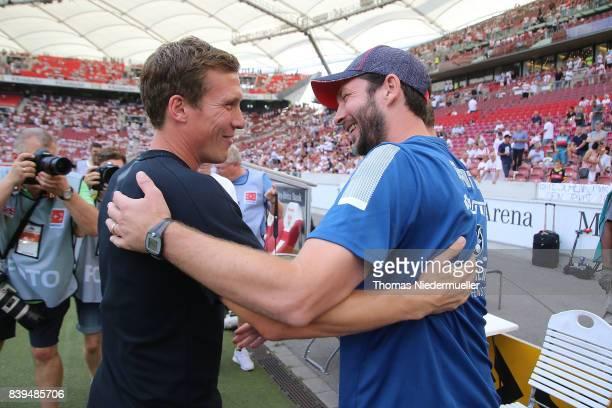 Hannes Wolf head coach of Stuttgart talks to Sandro Schwarz head coach of Mainz prior to the Bundesliga match between VfB Stuttgart and 1 FSV Mainz...