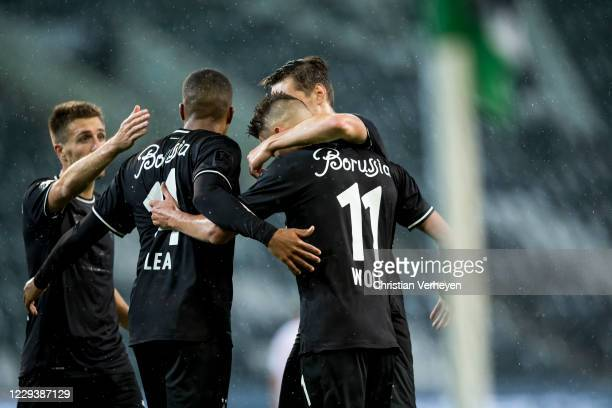 Hannes Wolf of Borussia Moenchengladbach celebrate with team mates after he score his teams first goal during the Bundesliga match between Borussia...