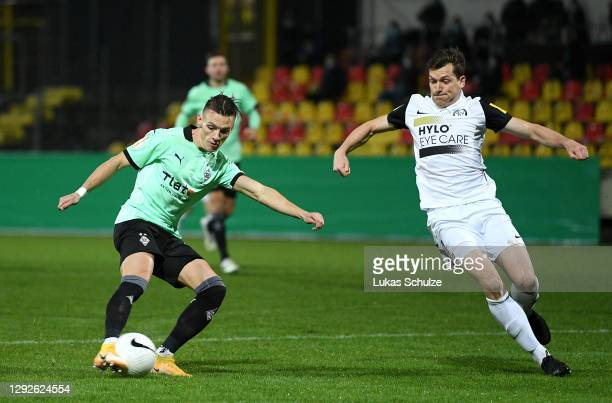 Hannes Wolf of Borussia Monchengladbach scores their team's first goal as Lukas Kohler of SV Elversberg attempts to block during the DFB Cup second...