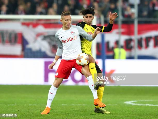 Hannes Wolf of Salzburg and Mahmoud Dahoud of Dortmund battle for the ball during UEFA Europa League Round of 16 second leg match between FC Red Bull...
