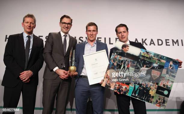 Hannes Wolf poses with Frank Wormuth Friedrich Curtius and Lars Ricken after being awarded 'Coach of the Year' during the Coaching Award Ceremony...