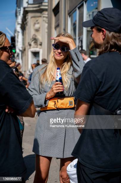 Hanni Gohr outside MFPEN wearing grey blazer with belt and orange Carhartt belt bag during Copenhagen fashion week SS21 on August 12 2020 in...