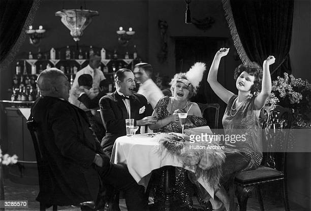 Hanni Weisse Maly Delschaft and Brunn Kashmar enjoying themselves in a restaurant scene from the German film 'Die Drei Portiermadels'