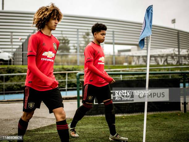 Hannibal Mejbri and Shola Shoretire of Manchester United U18s walk out ahead of the U18 Premier League match between Manchester City U18s and...