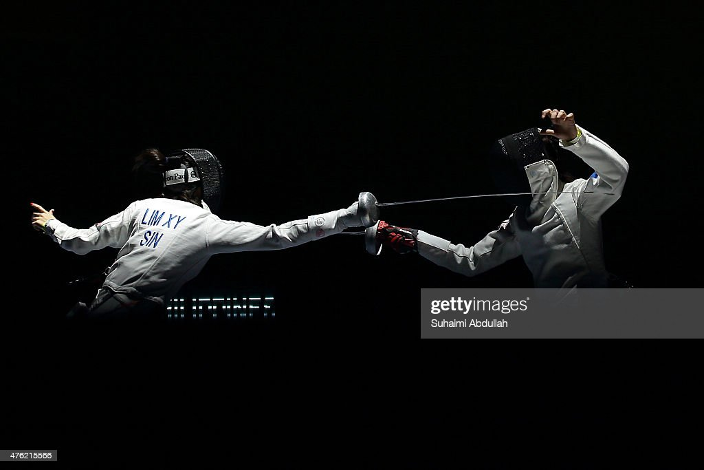 Hanniel Abella of Philippines (R) fights Lim Xiu Yan Victoria Ann of Singapore (L) in the women's fencing team epee semifinals at the OCBC Arena Hall during the 2015 SEA Games on June 7, 2015 in Singapore.