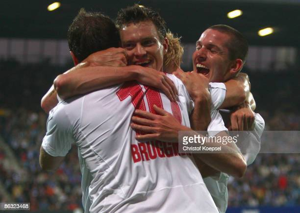 Hanno Balitsch of Hannover celebrates the second goal with Arnold Bruggink and Leon Andreasen during the Bundesliga match between VfL Bochum and...