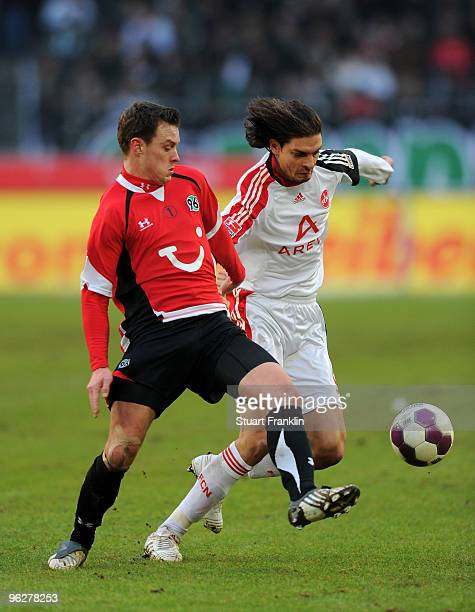 Hanno Balitsch of Hannover challenges Angelos Charisteas of Nuernberg during the Bundesliga match between Hannover 96 and FC Nuernberg at AWDArena on...
