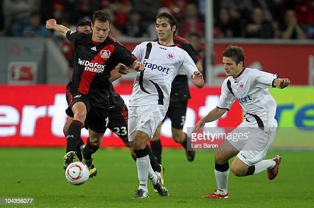 Hanno Balitsch of LEverkusen is challenged by Halil Altintop and Pirmin Schwegler of Frankfurt during the Bundesliga match between Bayer Leverkusen...