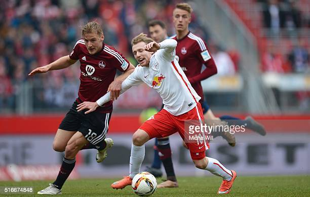 Hanno Behrens of Nuernberg and Emil Forsberg of Leipzig compete for the ball during the Second Bundesliga match between 1 FC Nuernberg and RB Leipzig...