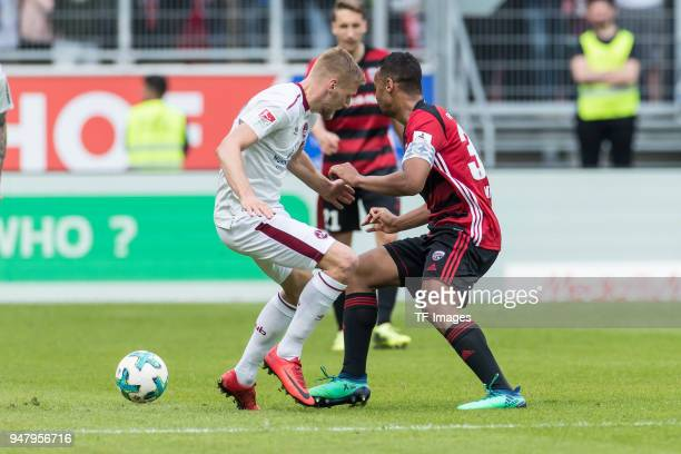 Hanno Behrens of Nuernberg and Marvin Job Matip of Ingolstadt battle for the ball during the Second Bundesliga match between FC Ingolstadt 04 and 1...