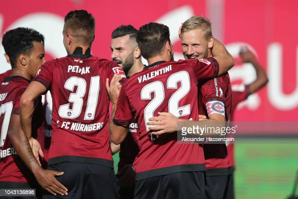 Hanno Behrens of Nuernberg celebartes scoring the opening goal with his team mates during the Bundesliga match between 1. FC Nuernberg and Fortuna...