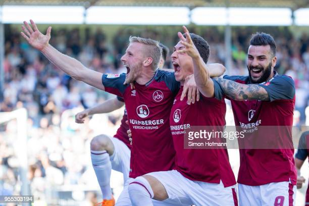 Hanno Behrens of Nuernberg celebrates his team's first goal with team matew Georg Margreitter during the Second Bundesliga match between SV...