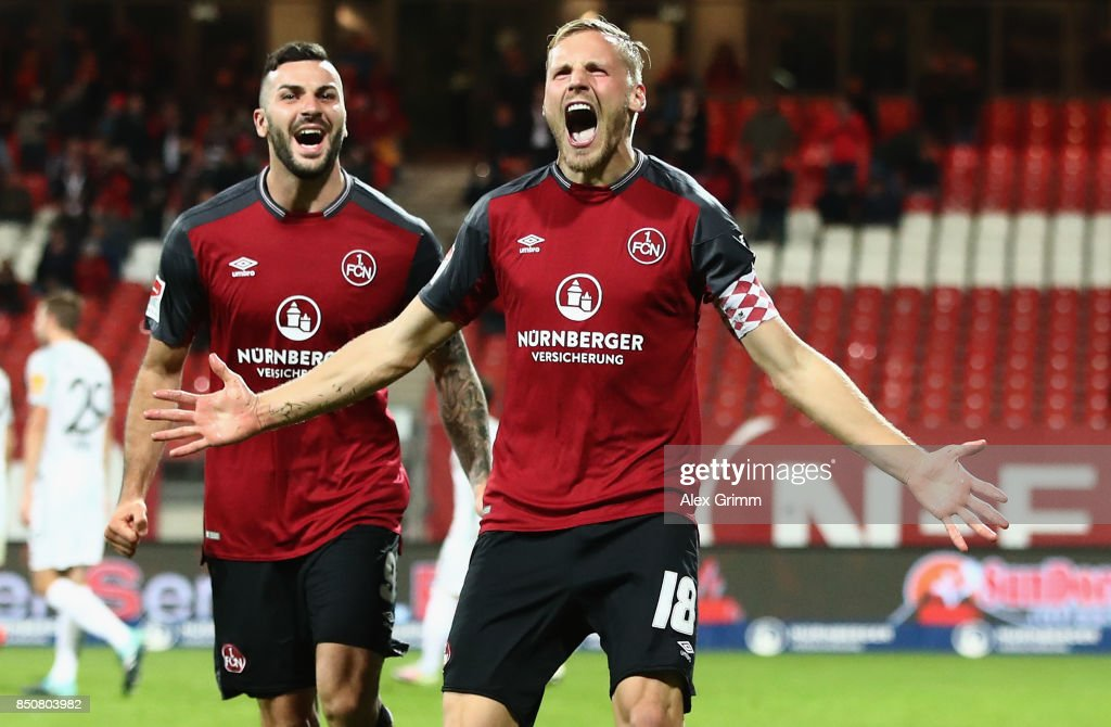 Hanno Behrens (front) of Nuernberg celebrates his team's second goal with team mate Mikael Ishak during the Second Bundesliga match between 1. FC Nuernberg and VfL Bochum 1848 at Max-Morlock-Stadion on September 21, 2017 in Nuremberg, Germany.
