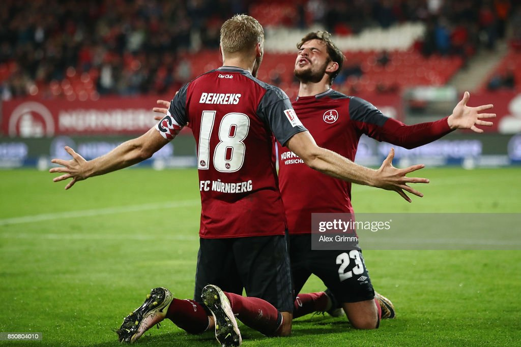 Hanno Behrens (front) of Nuernberg celebrates his team's second goal with team mate Tim Leibold during the Second Bundesliga match between 1. FC Nuernberg and VfL Bochum 1848 at Max-Morlock-Stadion on September 21, 2017 in Nuremberg, Germany.