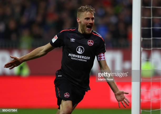 Hanno Behrens of Nuernberg celebrates scoring his second goal his teams third goal during the Second Bundesliga match between Holstein Kiel and 1 FC...