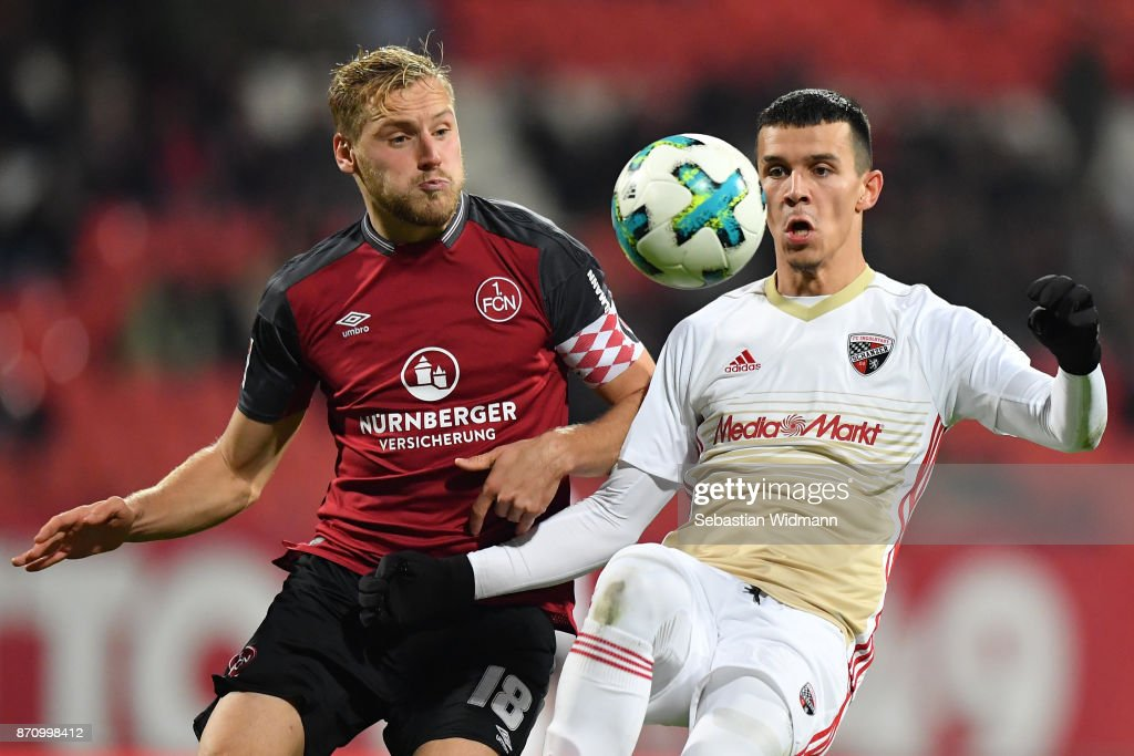Hanno Behrens2 of 1.FC Nuernberg and Alfredo Morales of FC Ingolstadt 04 compete for the ball during the Second Bundesliga match between 1. FC Nuernberg and FC Ingolstadt 04 at Max-Morlock-Stadion on November 6, 2017 in Nuremberg, Germany.