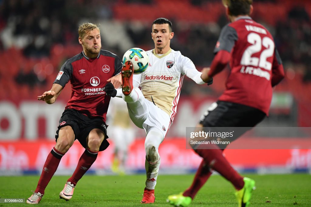 Hanno Behrens of 1.FC Nuernberg and Alfredo Morales of FC Ingolstadt 04 compete for the ball during the Second Bundesliga match between 1. FC Nuernberg and FC Ingolstadt 04 at Max-Morlock-Stadion on November 6, 2017 in Nuremberg, Germany.