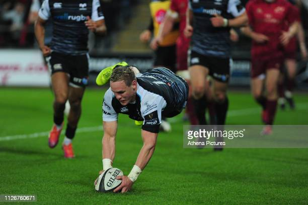Hanno Dirksen of Ospreys scores his side's first try during the Guinness Pro14 Round 16 match between Ospreys and Munster Rugby at the Liberty...