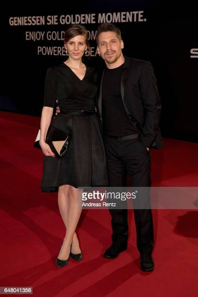Hanno Koffler and partner arrive for the Goldene Kamera on March 4 2017 in Hamburg Germany